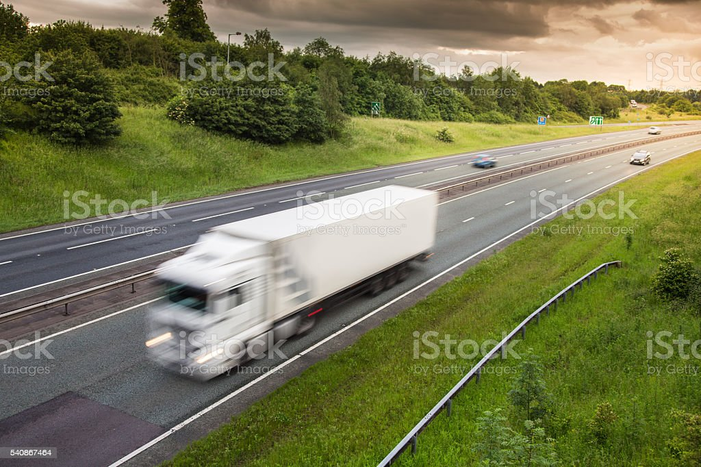Truck in motion on motorway stock photo