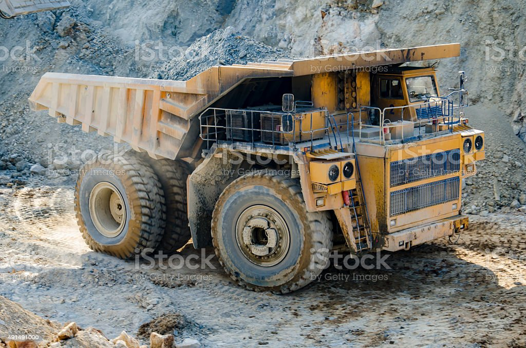 Truck in open pit mine stock photo