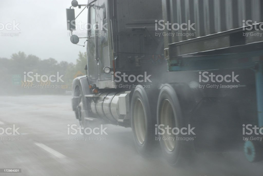 Truck in rainstorm royalty-free stock photo