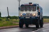 Truck Kamaz-Master russian team on civil road, near Moscow