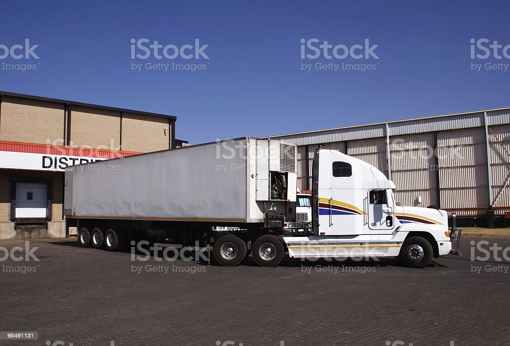 Truck manouvering onto dock royalty-free stock photo