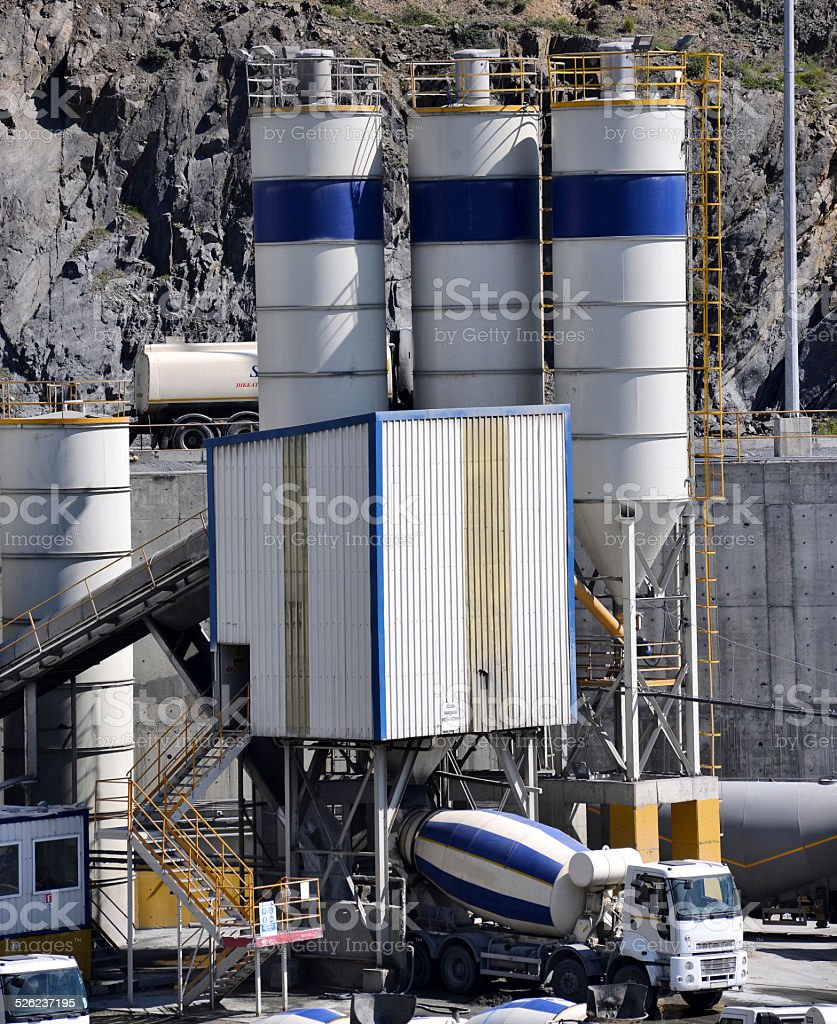 Truck mixer stands on concrete plant stock photo