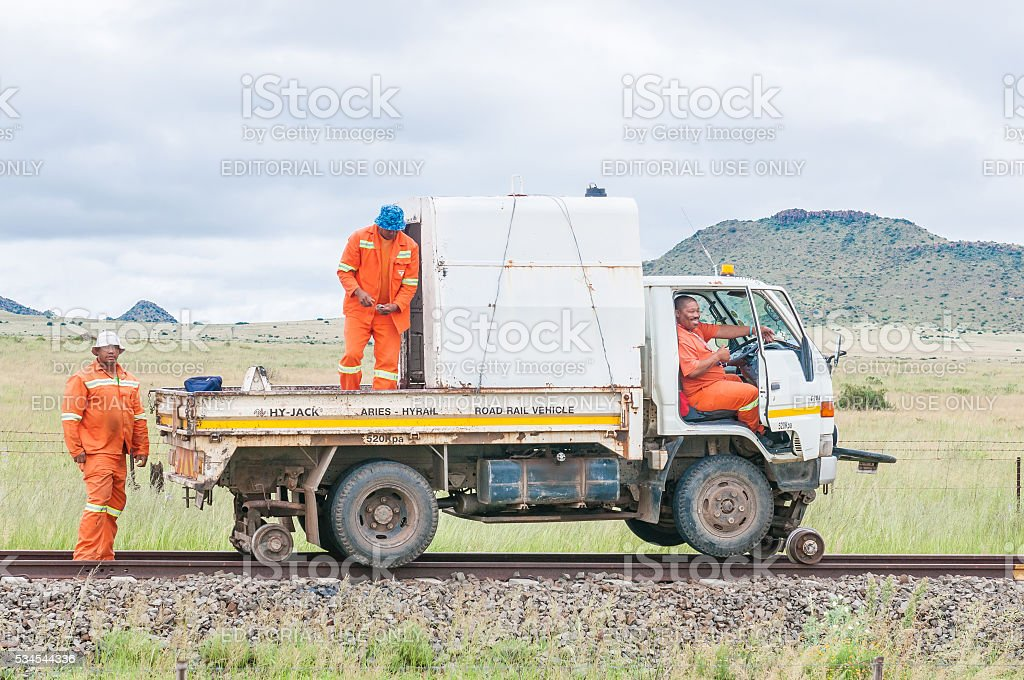 Truck modified to drive on railroad tracks stock photo