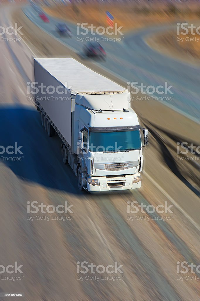 truck moves on highway stock photo