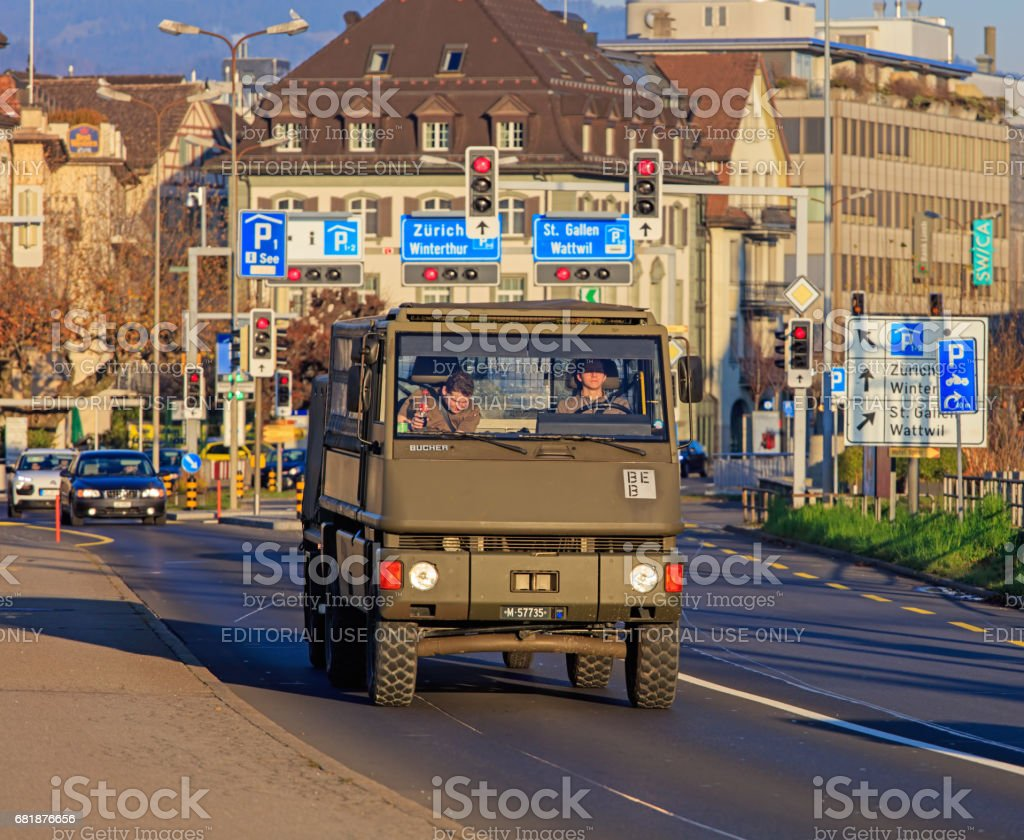 A truck of the Swiss Army on the road stock photo