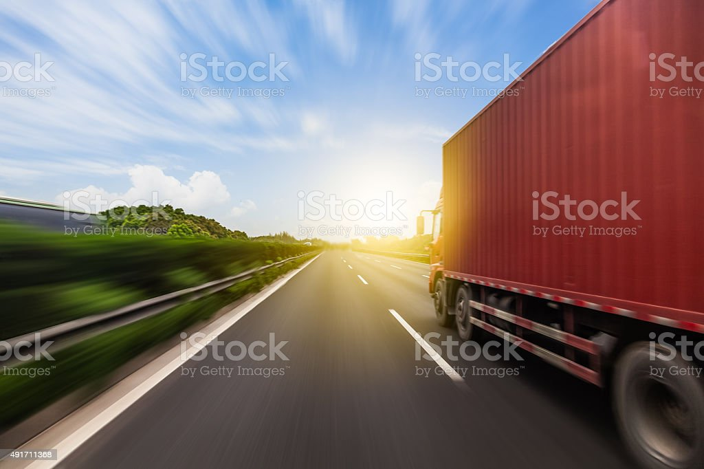 Truck on a fast express road, motion blur stock photo