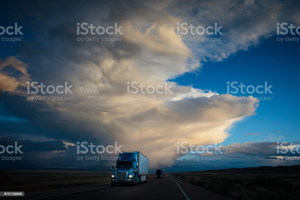 Truck on American Highway Dramatic Twilight Sky stock photo