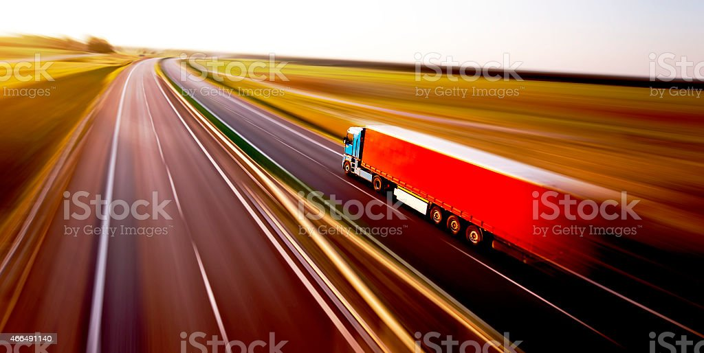 Truck on asphalt road motion blur stock photo