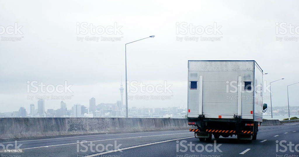 Truck on Auckland Harbour Bridge, New Zealand stock photo