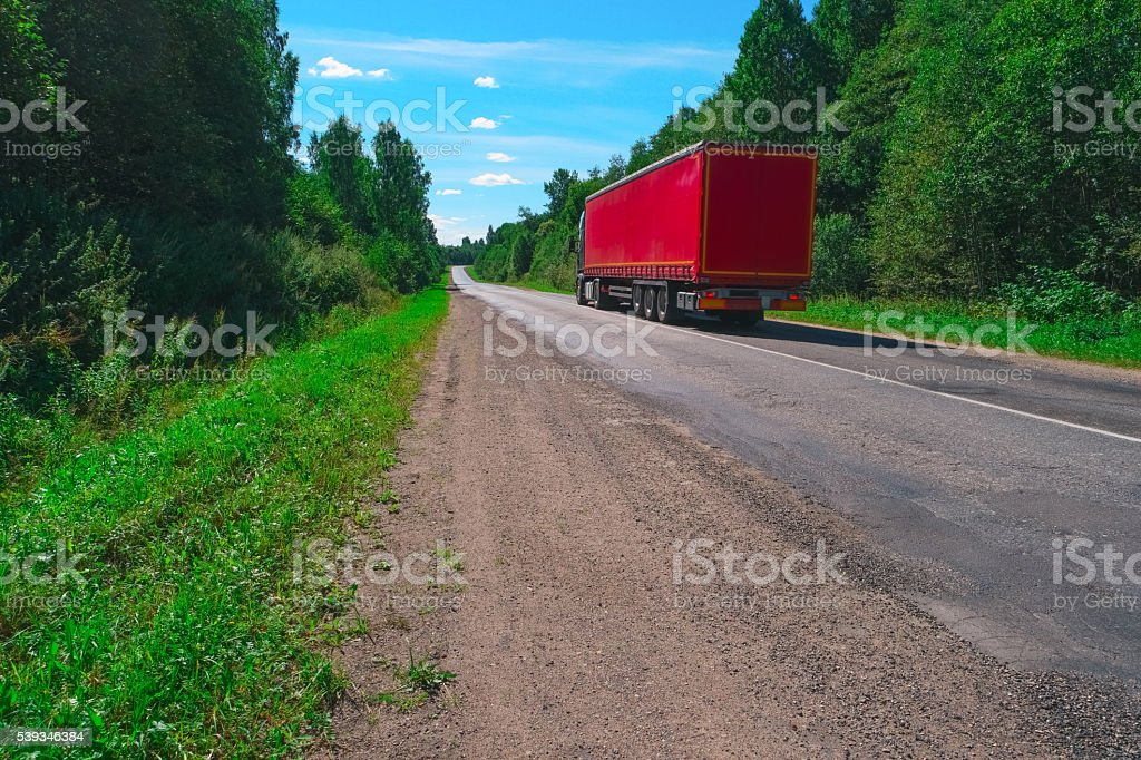 Truck on empty highway stock photo