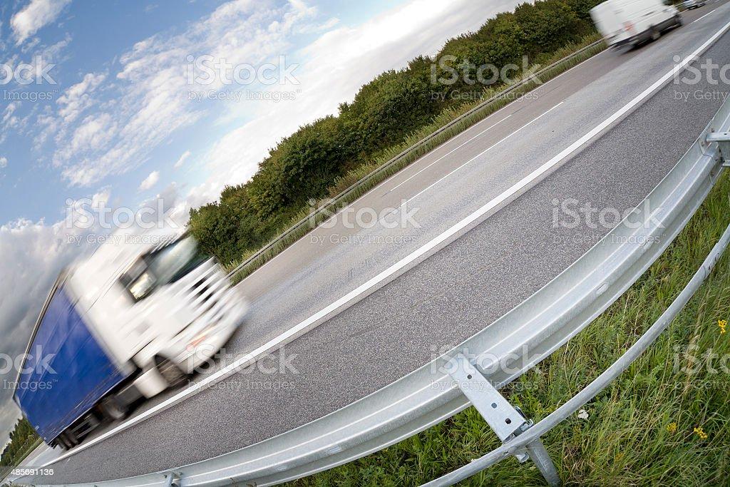 Truck on freeway - german Autobahn stock photo