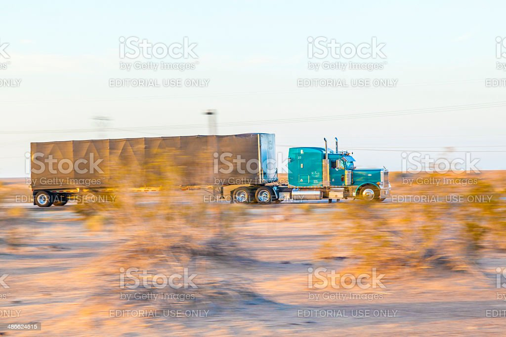 truck on highway 8 in sunrise stock photo