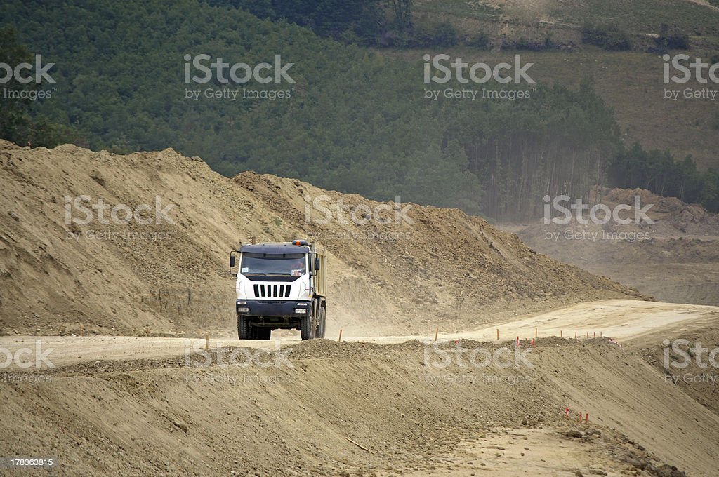 Truck on highway construction site royalty-free stock photo