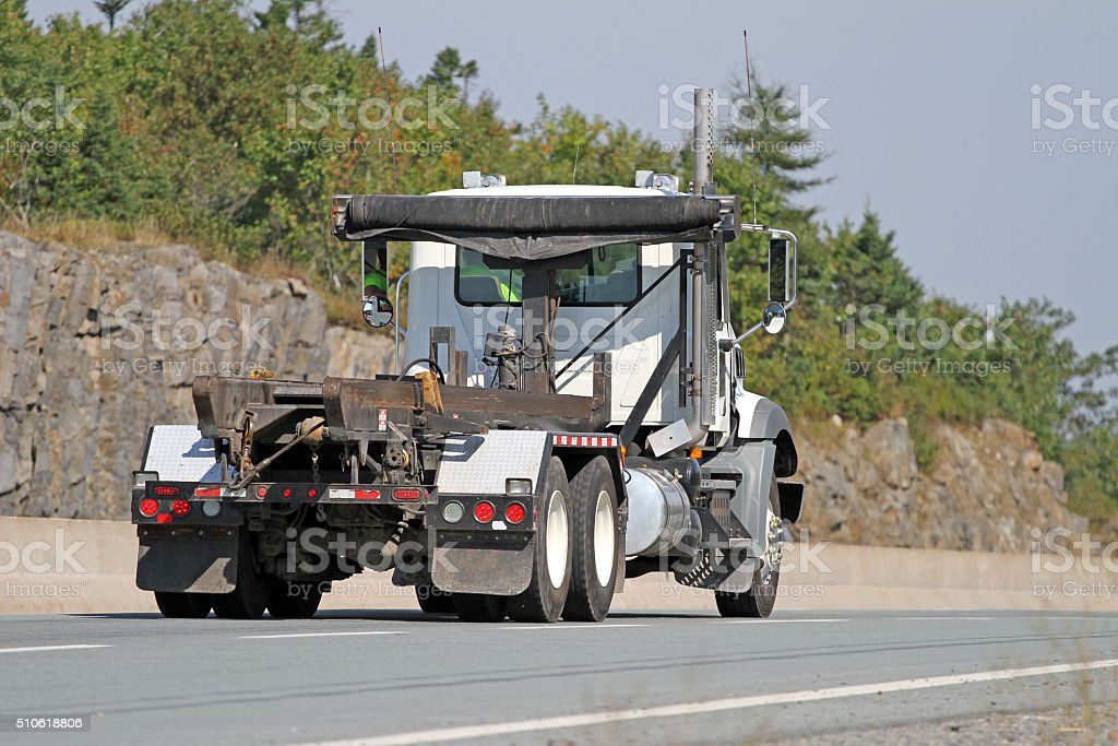Truck On Highway Equipped To Carry Industrial Waste Bins stock photo