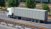 truck on road, industrial infrastructure and railroad, cargo transportation