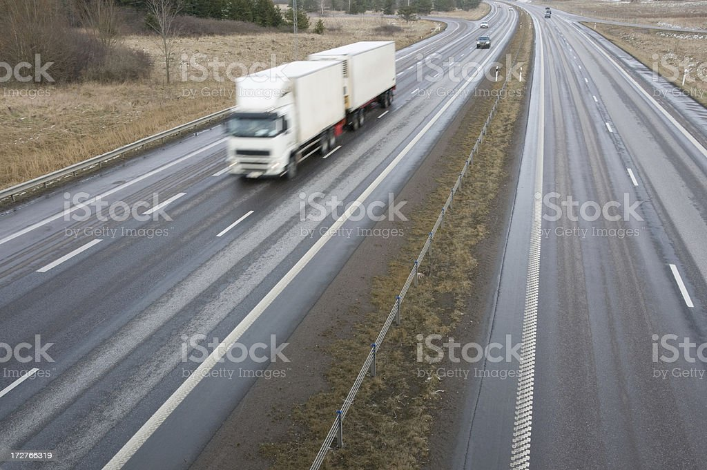 Truck on winter road stock photo