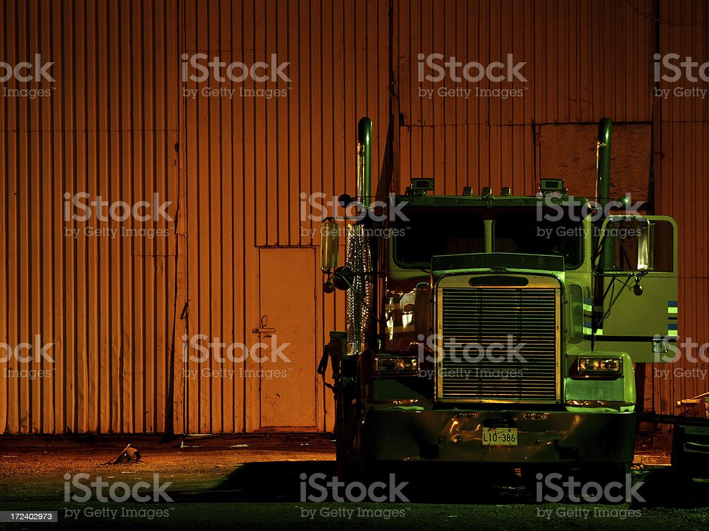 Truck Outside Warehouse at Night royalty-free stock photo