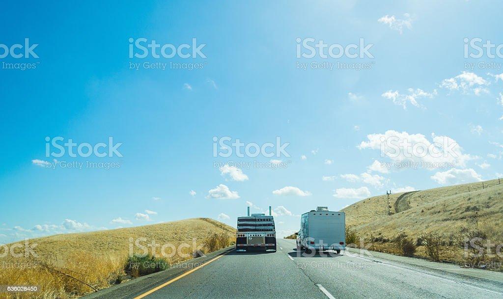 Truck overtaking a caravan in Interstate 5 stock photo