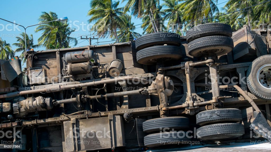 Truck overturned on the road stock photo