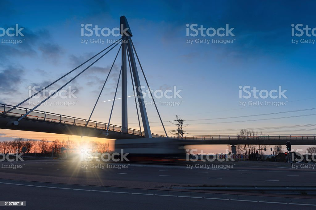 truck passing the futuristic bridge at Naaldwijk stock photo