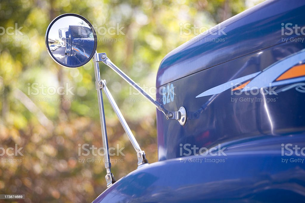 Truck reflected in wing mirror royalty-free stock photo