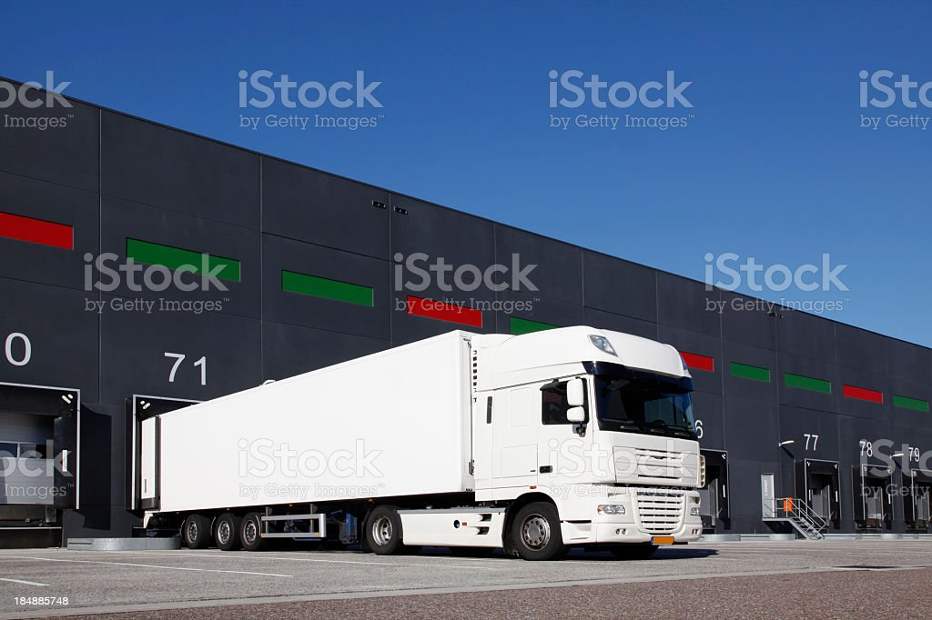 Truck reversed into a loading dock royalty-free stock photo