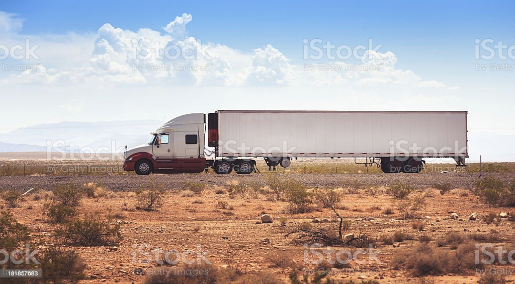 Truck running fast on US highway royalty-free stock photo