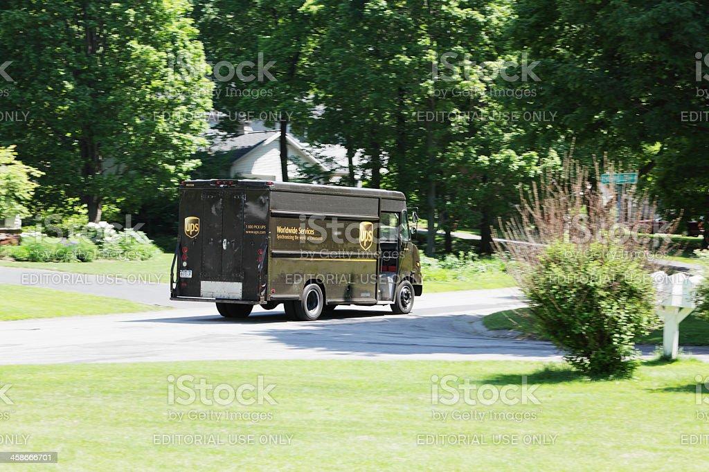 UPS Truck Rushing Through Suburban Neighborhood stock photo