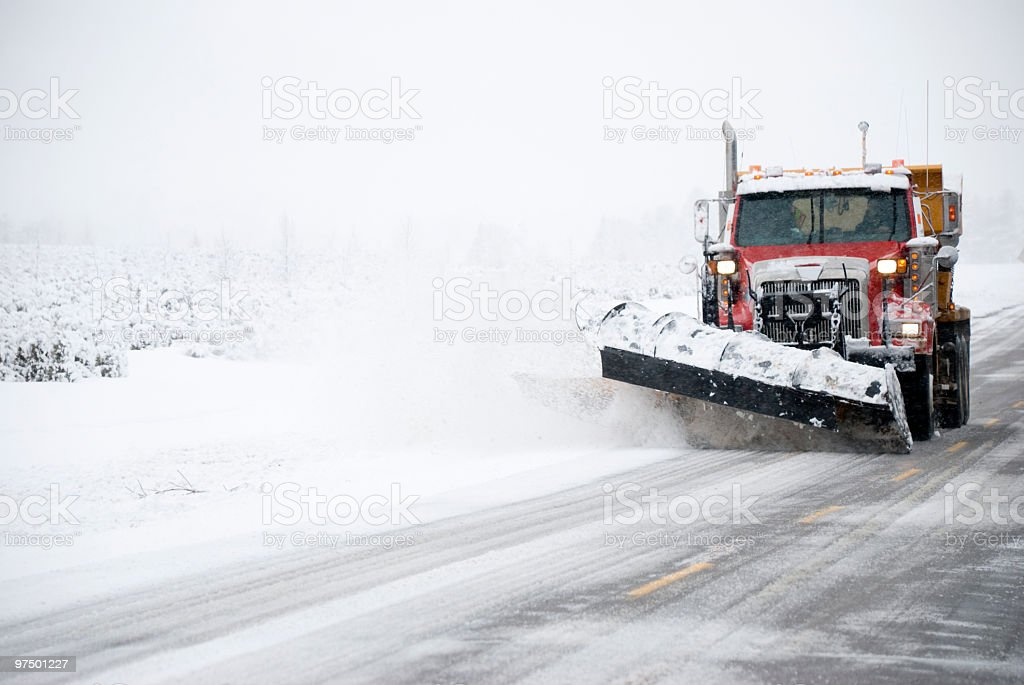 truck snow removal plow snowstorm spreader in storm stock photo