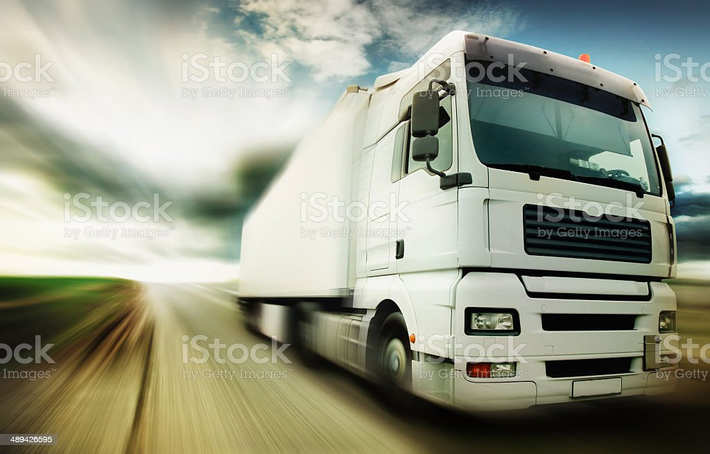 Truck speeding at country road stock photo