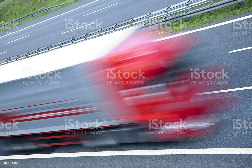 Truck speeding on highway, blurred motion, high angle view royalty-free stock photo