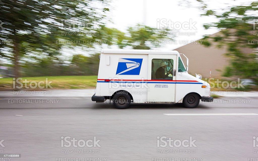 USPS truck speeding stock photo