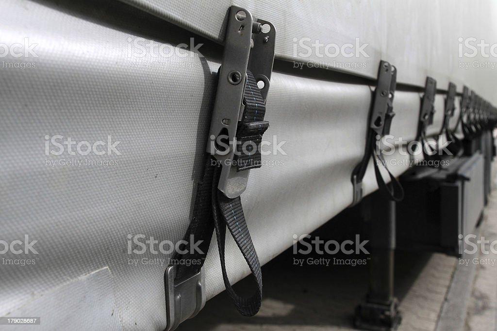 Truck tarp straps royalty-free stock photo