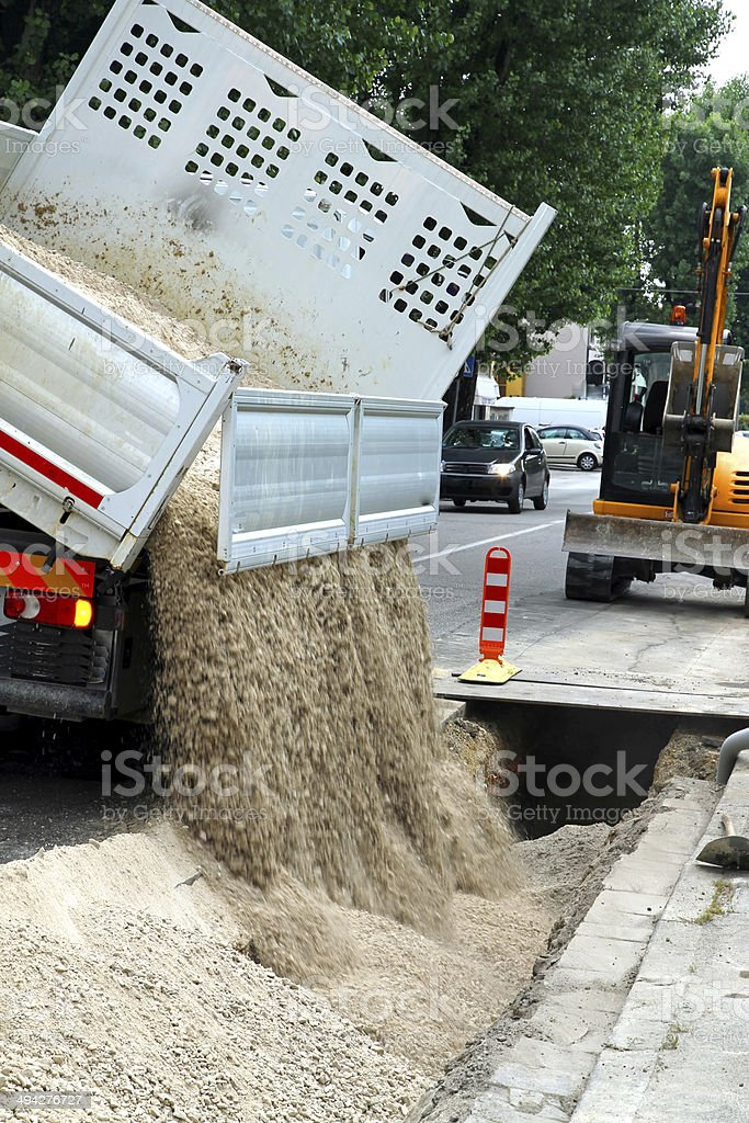 truck tipper during the emptying of the gravel stock photo