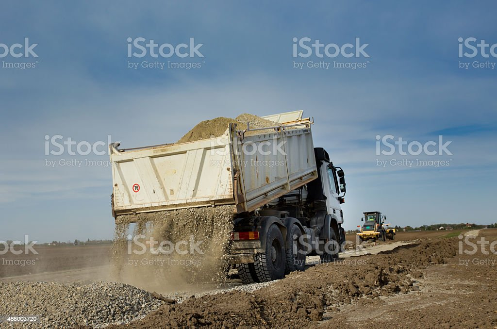Truck tipping gravel stock photo