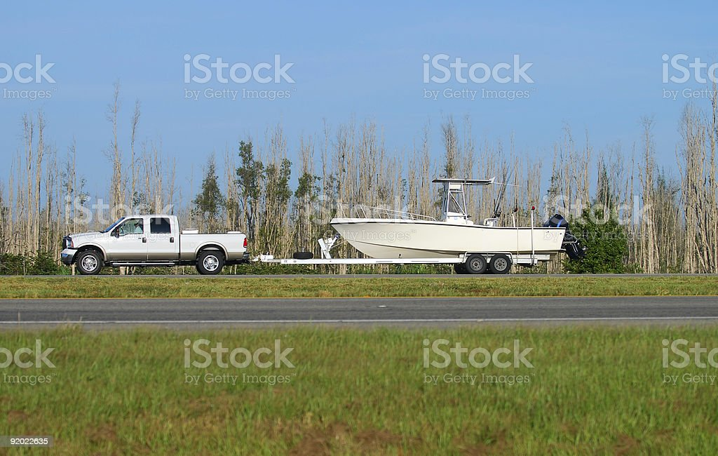 Truck towing boat stock photo