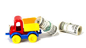 Truck toy on the road from money