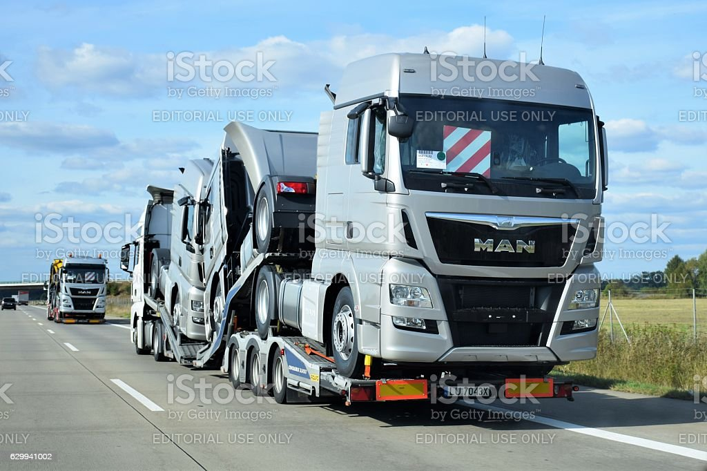Truck transporters driving on the highway stock photo