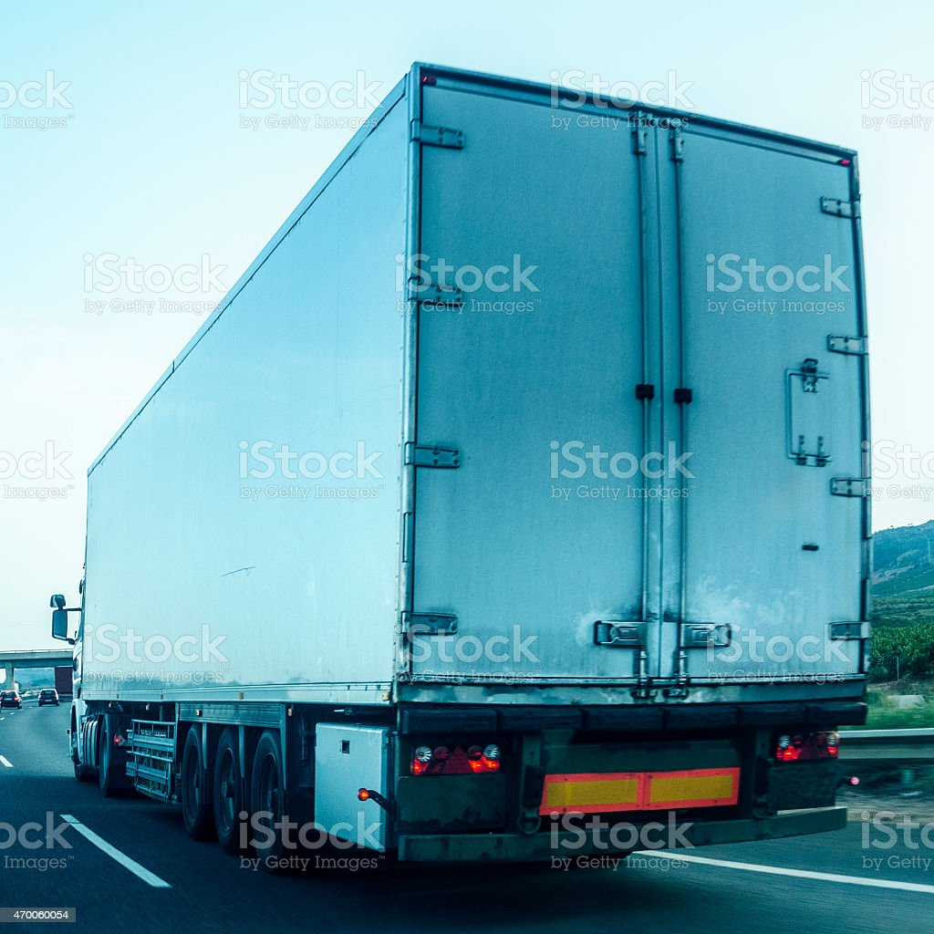 Truck Trucking seen from behind. stock photo