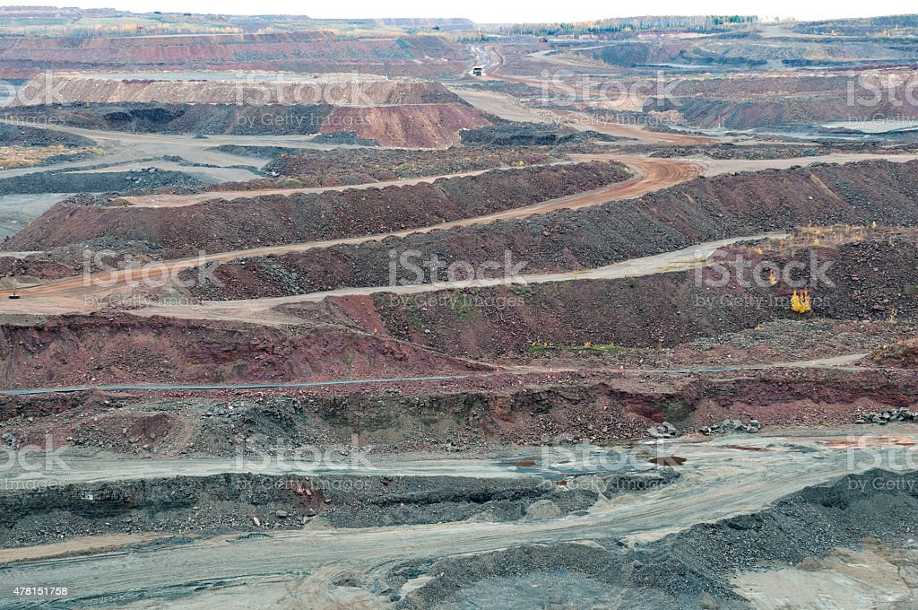 Truck watering road at iron ore mine in Minnesota stock photo