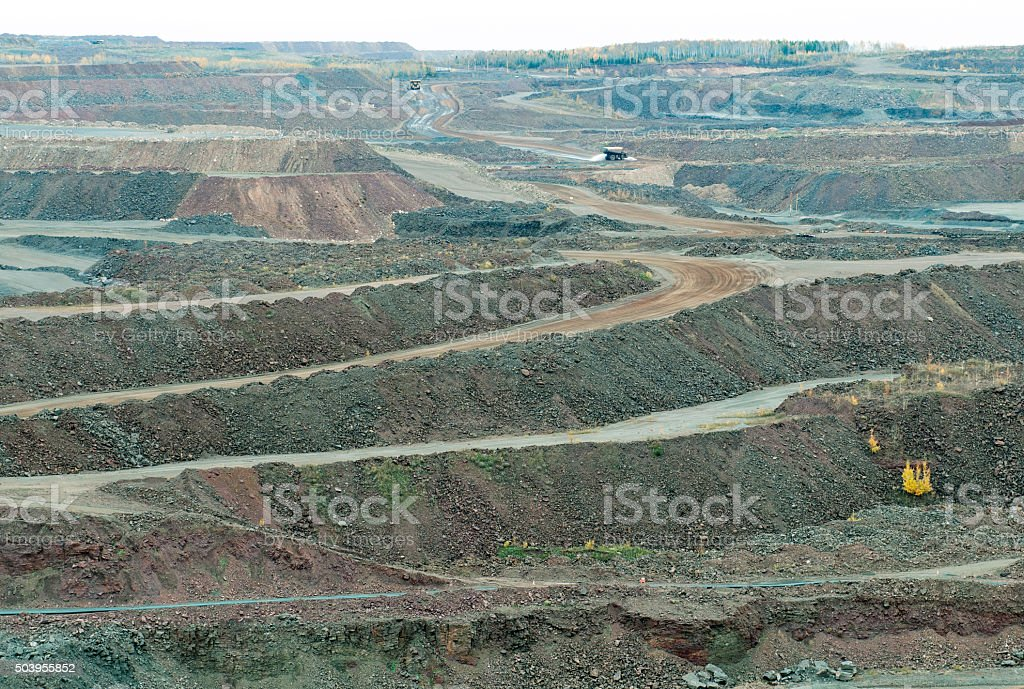 Truck watering roads of iron ore mine in northern Minnesota stock photo