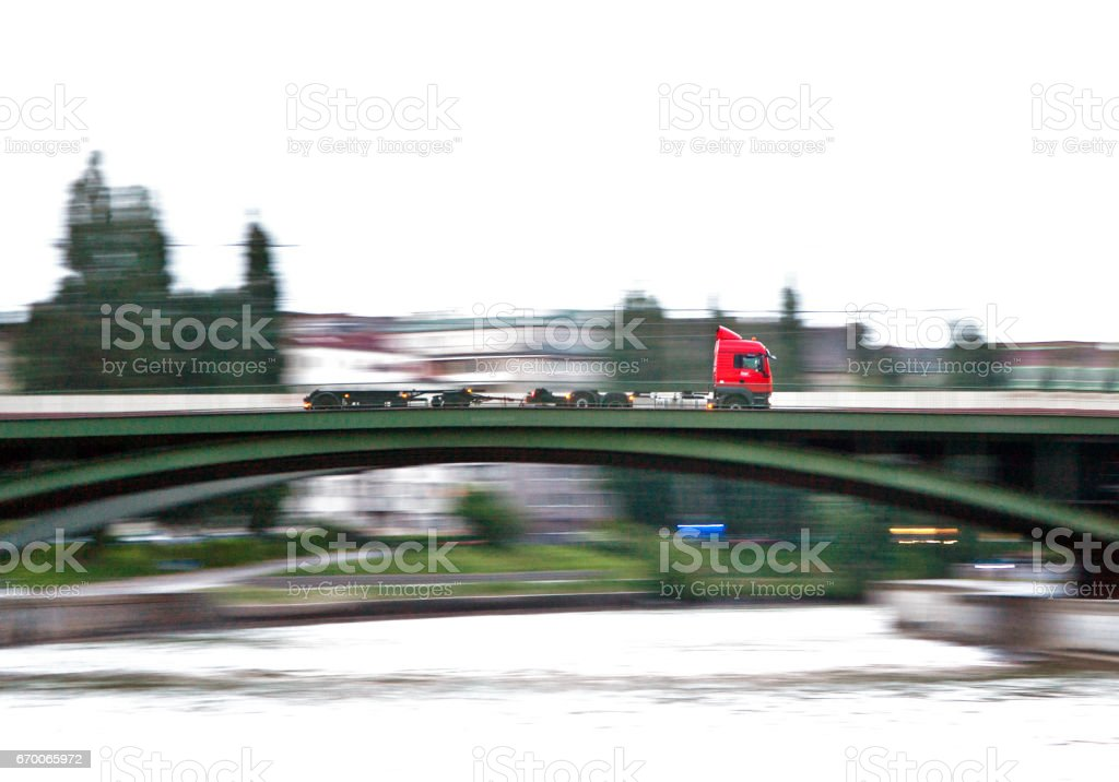 truck with high speed is crossing the bridge in vienna downtown stock photo