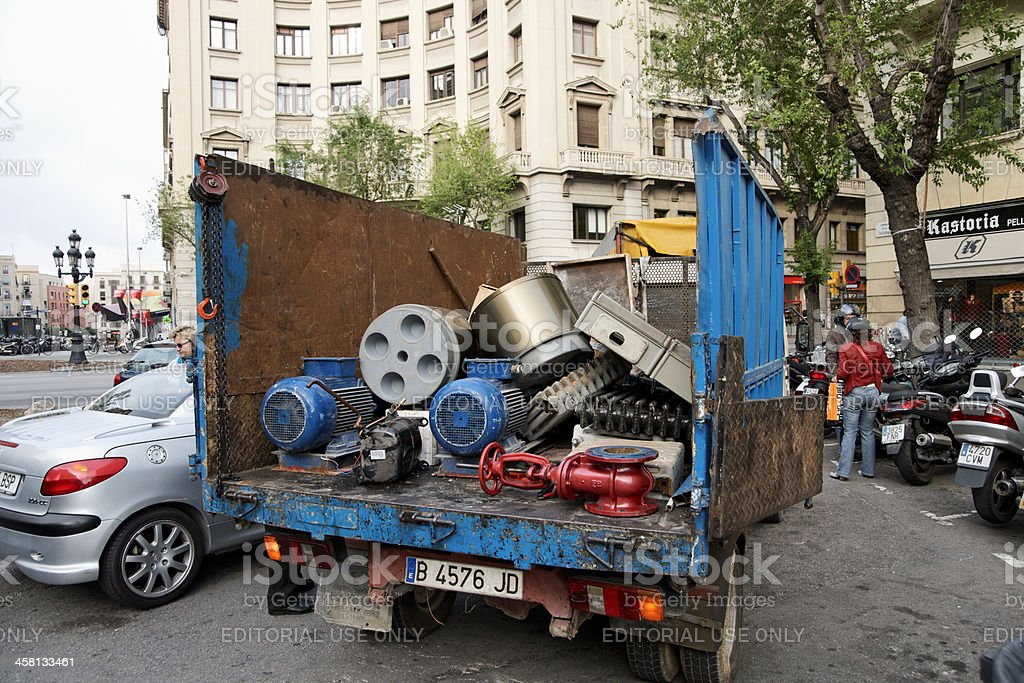 Truck with old metal parts in Barcelona, Spain royalty-free stock photo