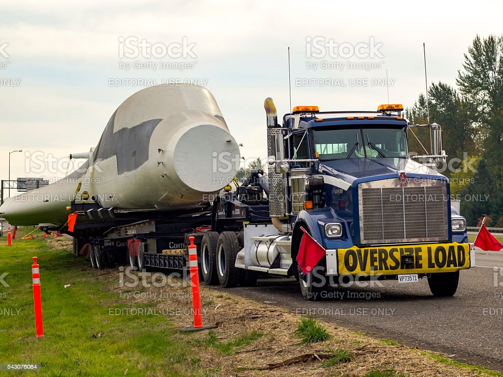 Truck with Oversize Load Sign Carring B-1 Bomber I-5 Oregon stock photo