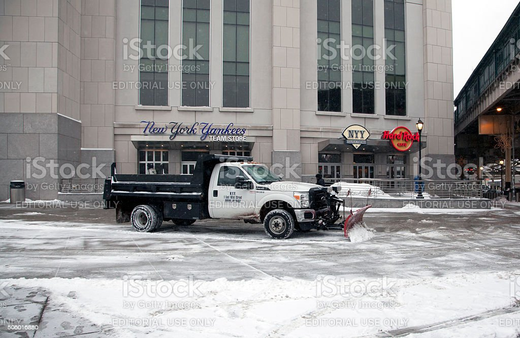 Truck with plow clears snow stock photo