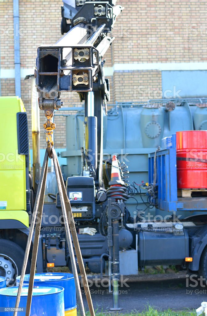 Truck with Telescopic Arm Raise the Cargo stock photo