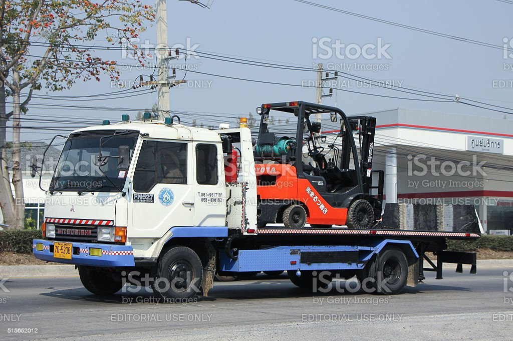 Truck with Toyota Forklift truck. TCP Petrolium Company stock photo