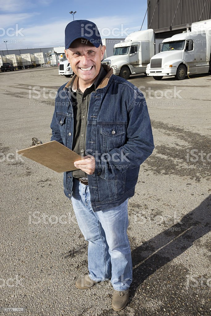 Trucker at a Warehouse stock photo
