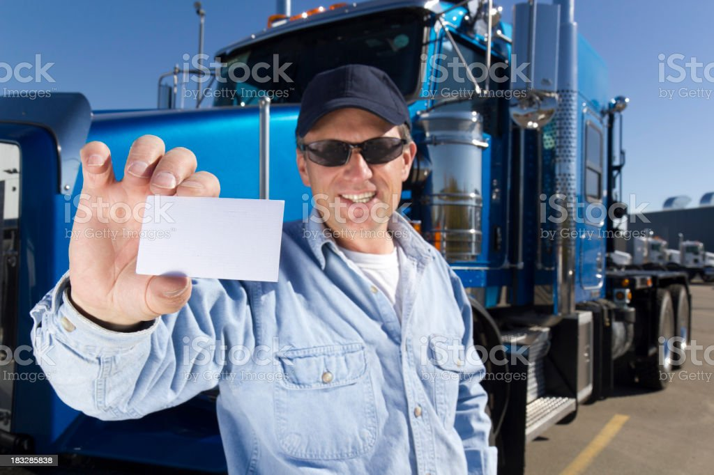 Trucker Holding a Card stock photo