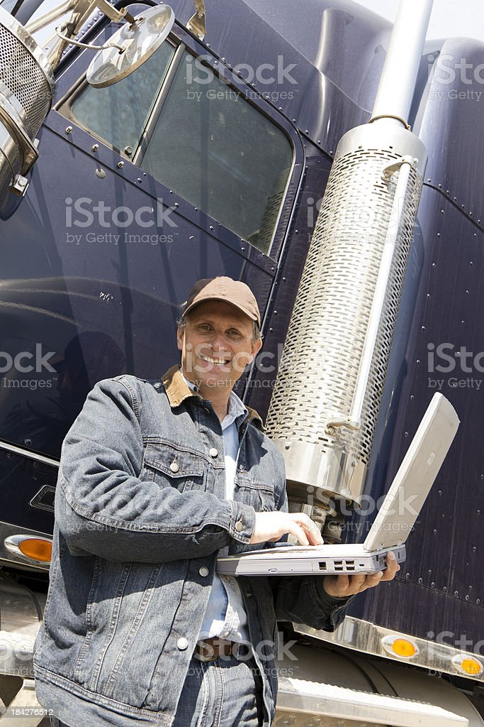 Trucker on a Laptop royalty-free stock photo